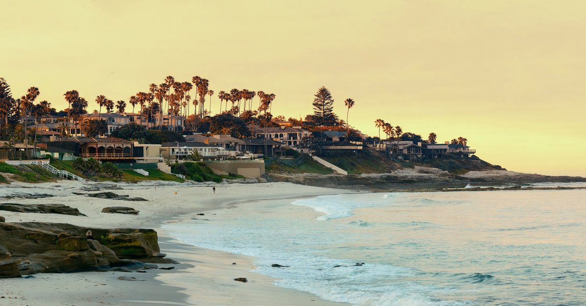 The La Jolla Beach during a yellow sunset, in California.