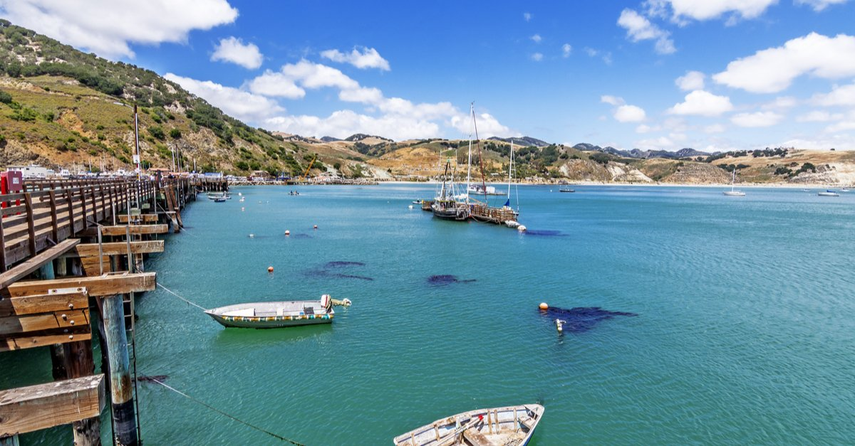 View of the blue ocean dotted with boats in San Luis Obispo, California.