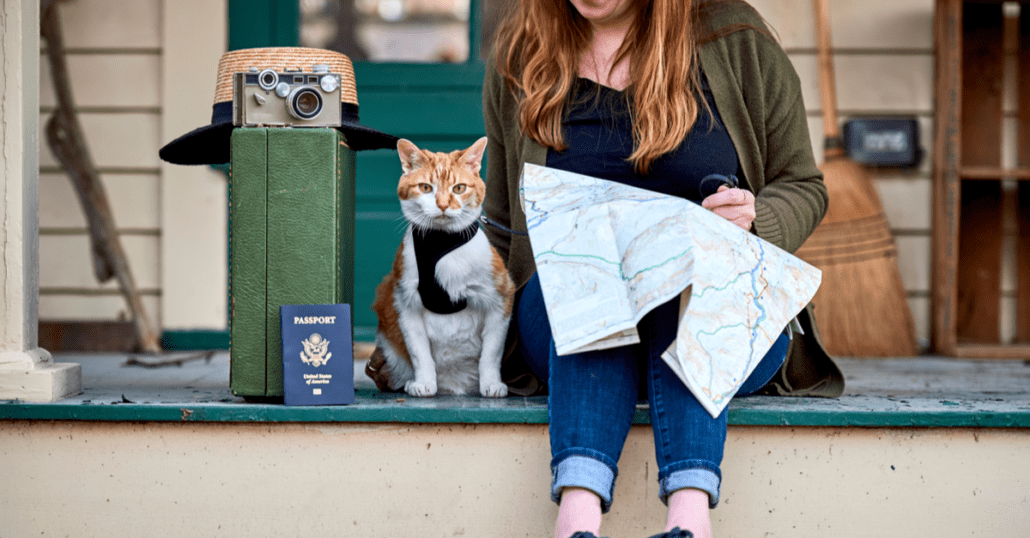 woman and her cat going on vacation