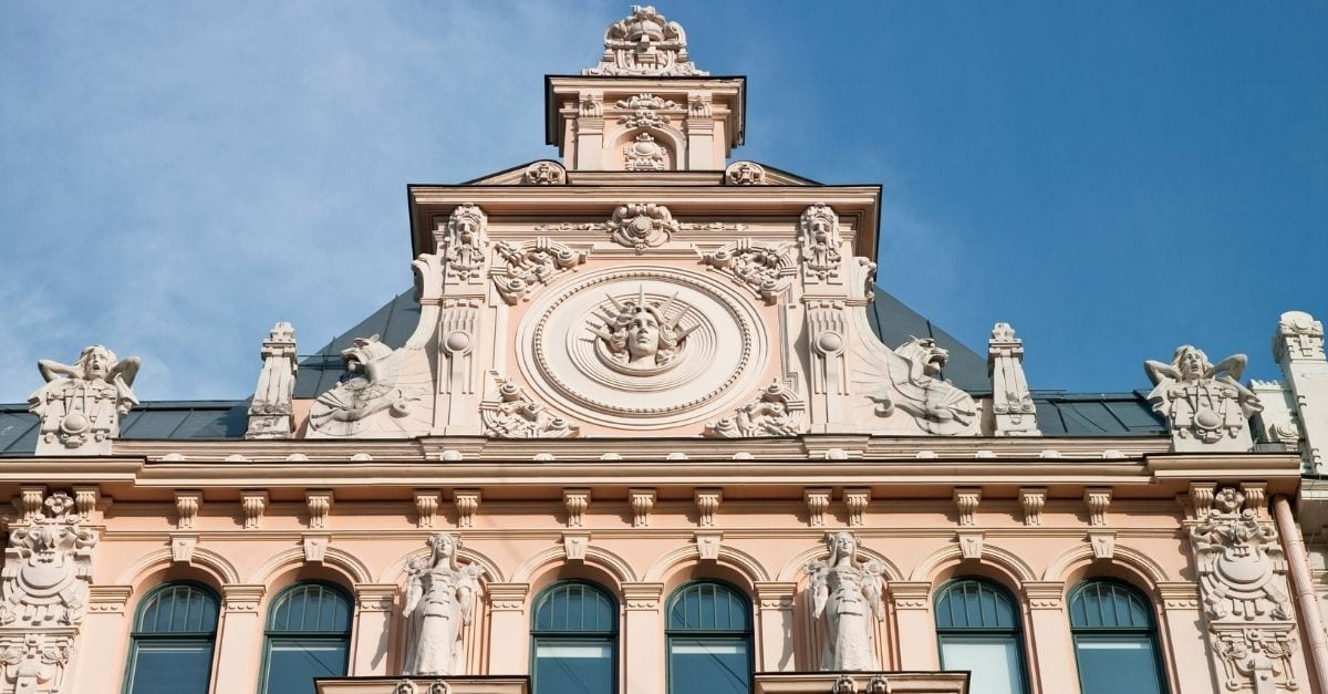 Light pink façade of an ornamented Art Nouveau Building.