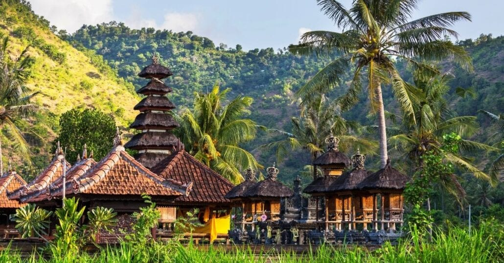 View of Balinese bungalows surrounded by the region's lush verdant forest.