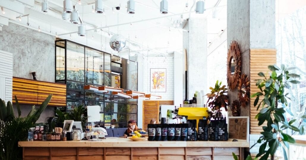 The interiors of a hippie chic cafe with plants.