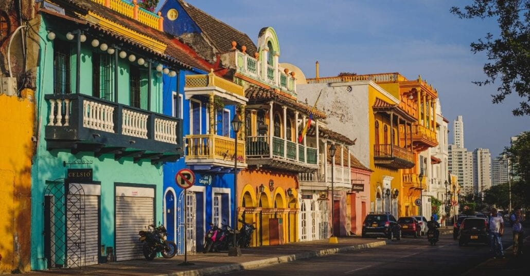 A street lined with colorful houses in Cartagena, Colombia.