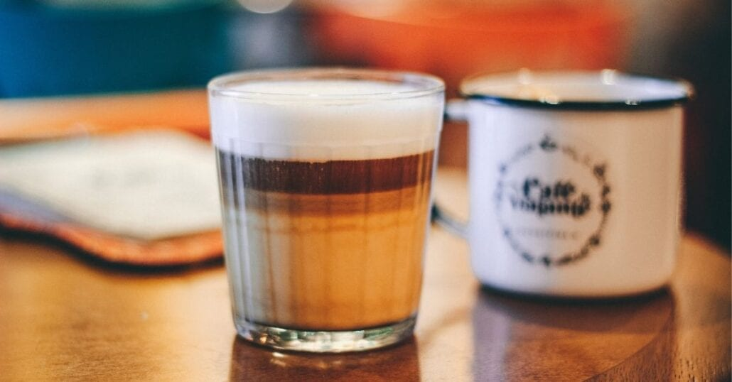 A shot coup filled with coffee and a rich, thick foam on top.