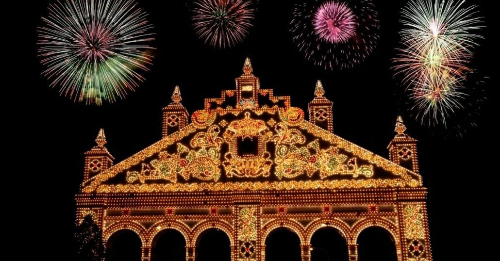 Colorful fireworks at night during the Seville Fair.