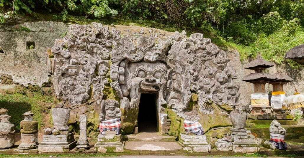 "Entrance of the Goa Gajah, also known as ""Elephant Cave"", which is carved with creatures and geometric patternes."