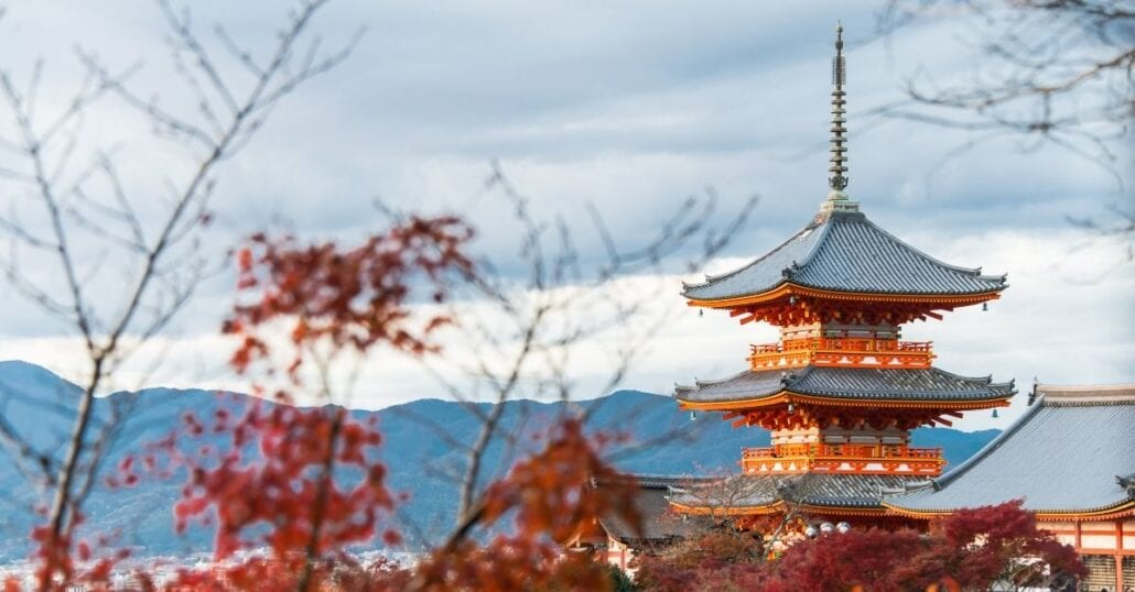 A red temple in Kyoto, Japan, during fall.