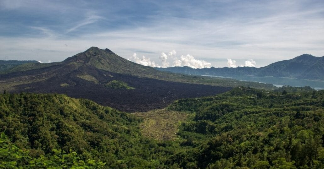 View of the Mount Batur surrounded by verdant forests.