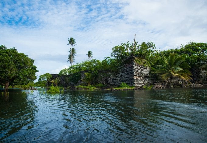 The Nan Madol waterways lined with megalithic constructions and forests.