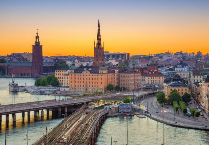 Aerial view of Stockholm's waterways and historical buildings at dusk.