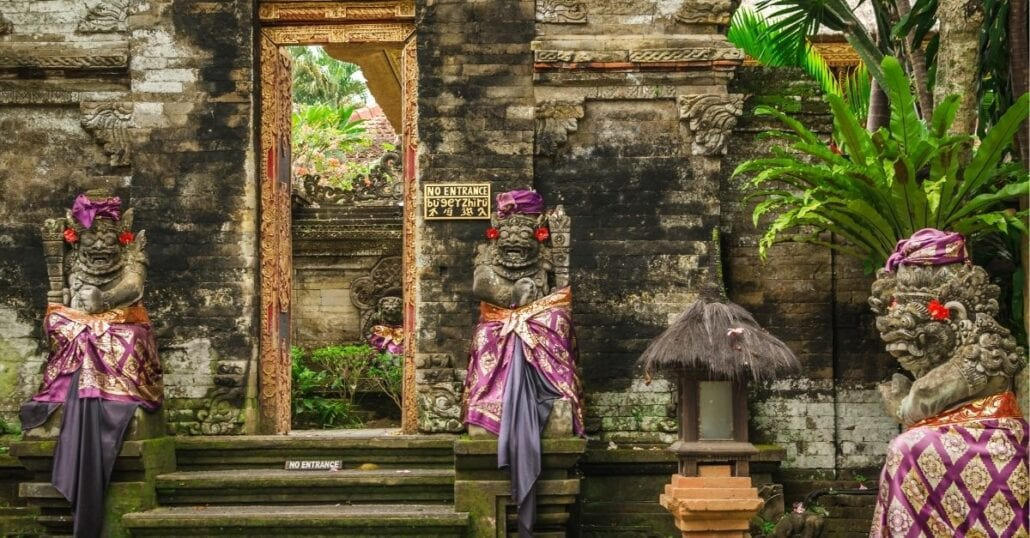 Sacred statues at the entrance of the Ubud Royal Palace, one of the top tourist attractions in Bali.