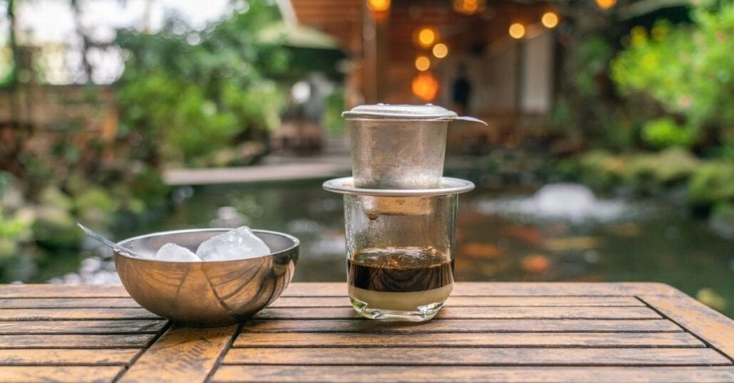 A cup of Vietnamese coffee is made using a Vietnamese Phin.