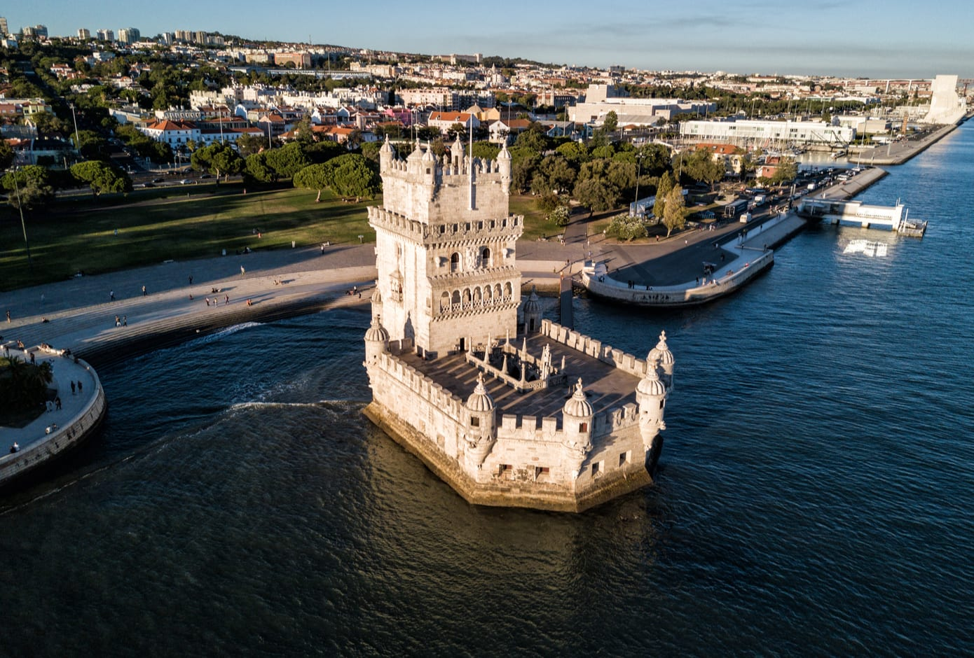 Aerial photo of the Belém Tower, in Lisbon, at sunset.