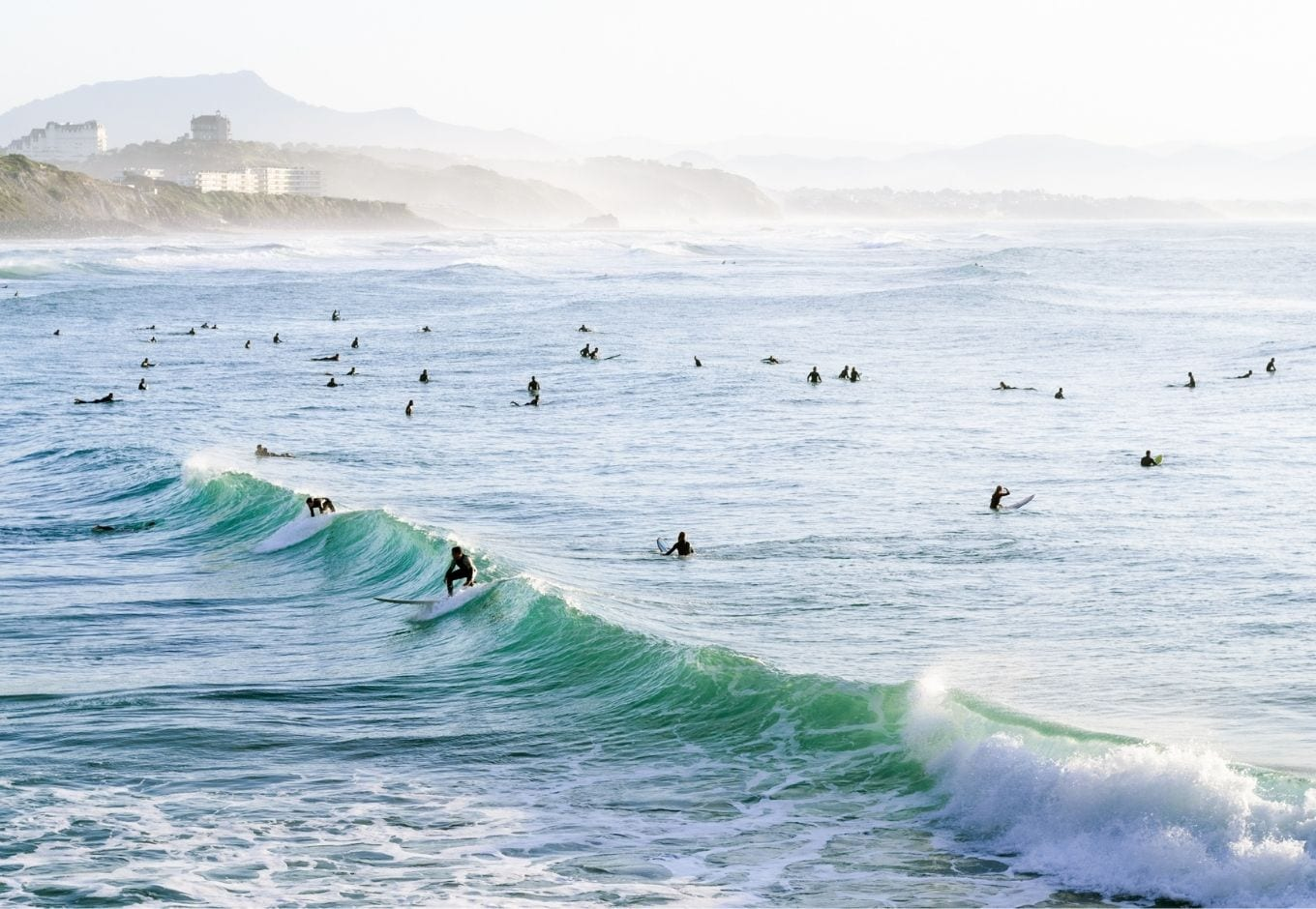 People surfing in Biarritz, France.