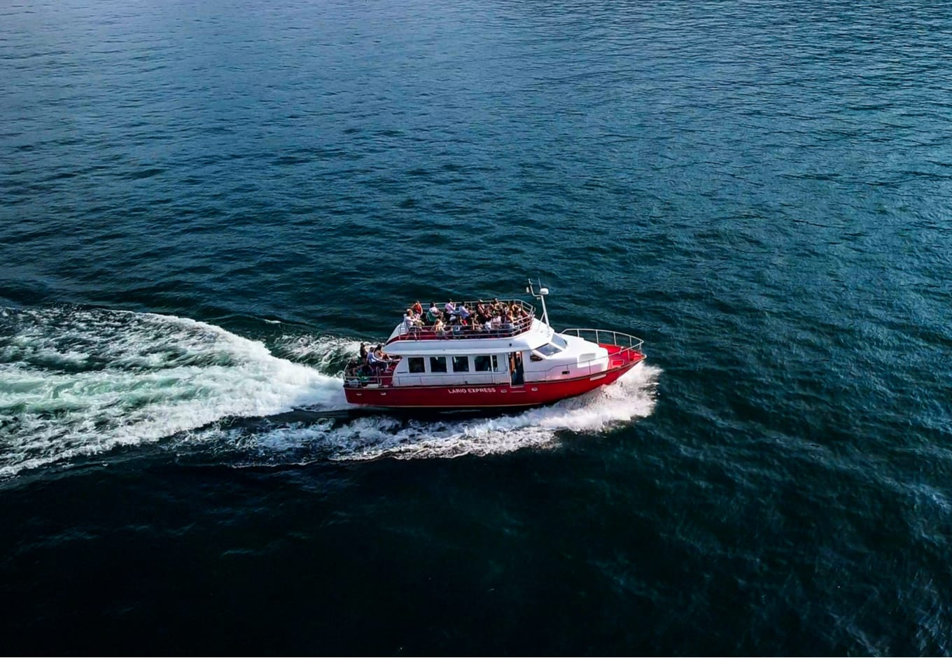 A white and red ferry transporting people.