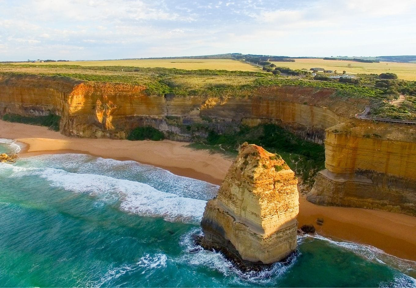 The turquoise ocean surrounded by cliffs on the Great Ocean Road, in Australia.