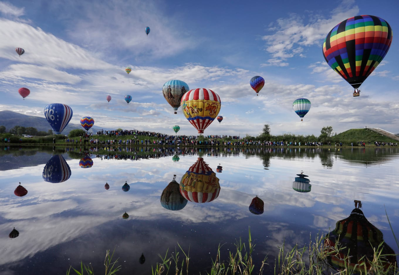 Balloons floatinh over Bald Eagle Lake, in Steamboat Springs Colorado.