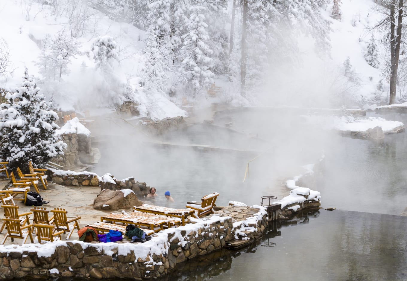 Strawberry Hot Springs, in Steamboat Springs, surrounded by a winter forest.