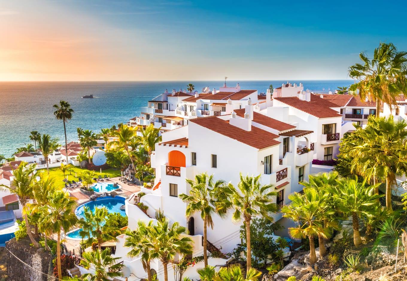 View of a seaside hotel surrounded by palm trees in Tenerife, Canary Islands, Spain.