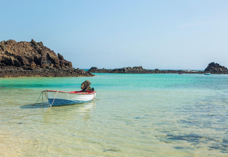 A boat on the blue-green ocean of Lobos Island, Canary Islands.