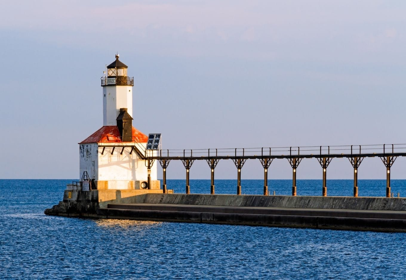 The Michigan City Lighthouse over the ocean.
