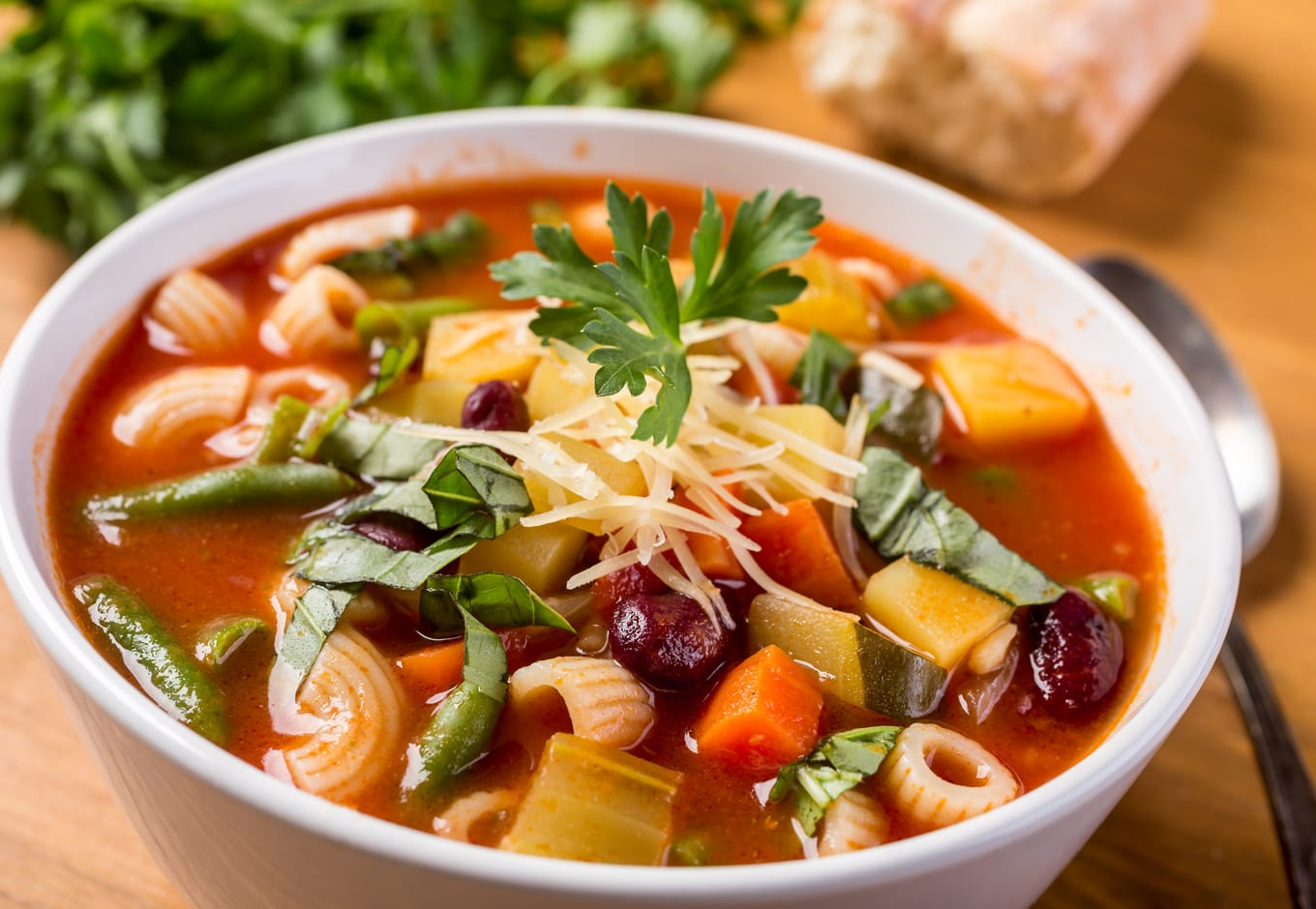 A bowl of Minestrone soup made with vegetables and pasta.