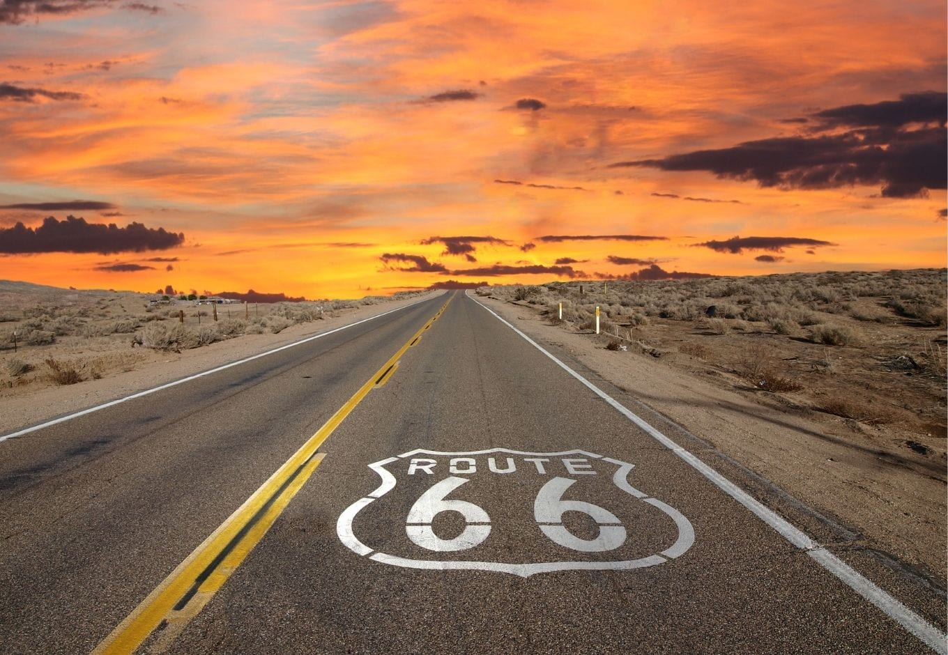 The route 66 during an orange sunset.