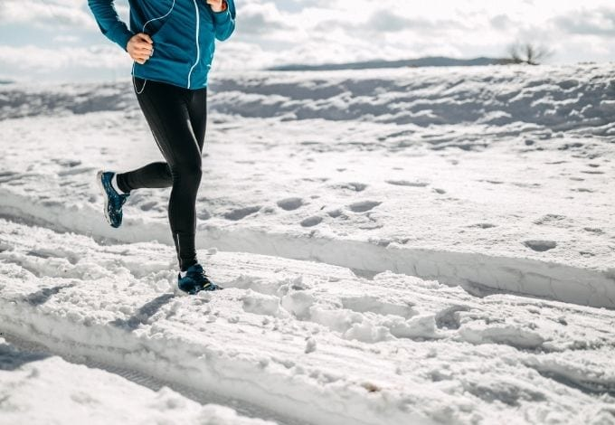 A person running in the snow.