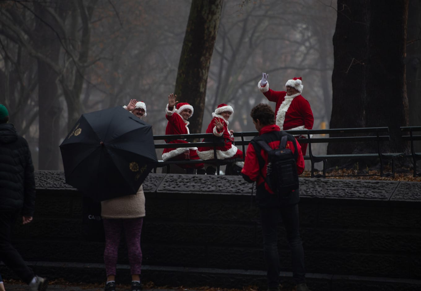 Men dressed in Santa outfits enjoying free outdoor events in NYC's Central Park