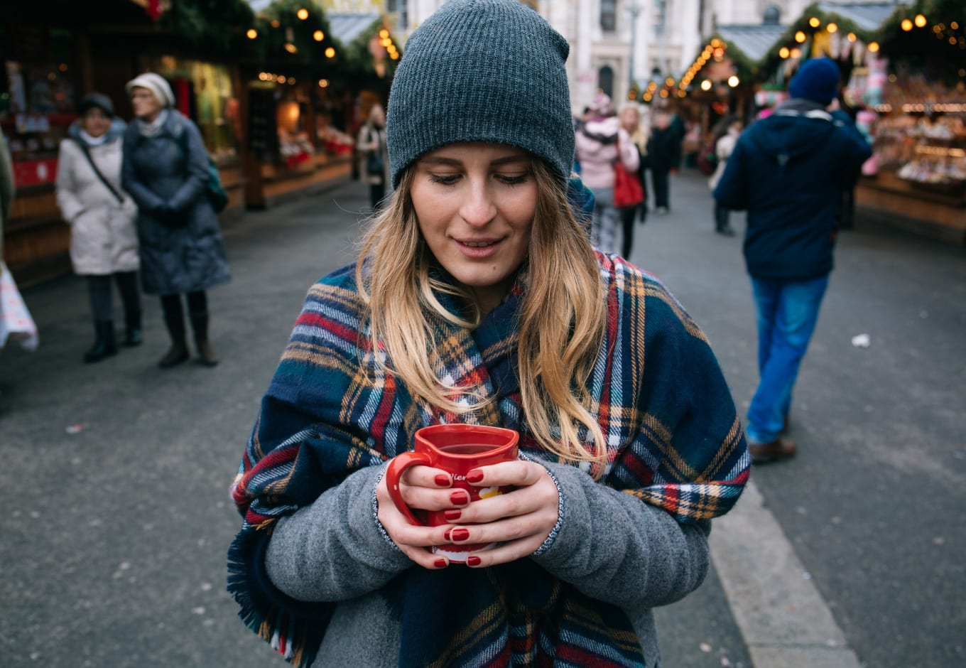 Girl sipping on holiday drinks in New York City, New York