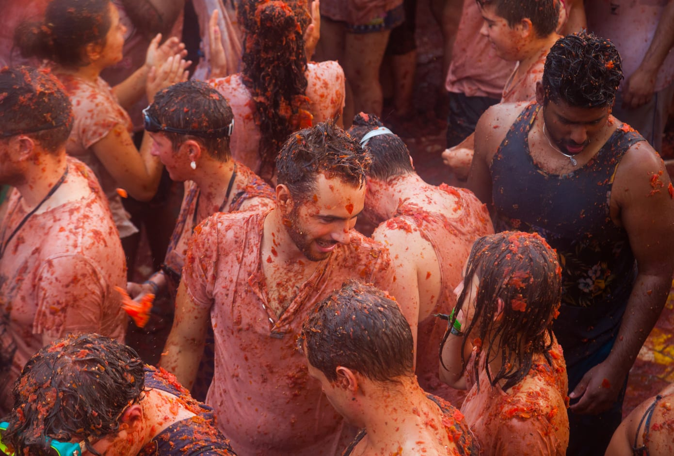 People covered in tomato juice during La Tomatina, in Spain