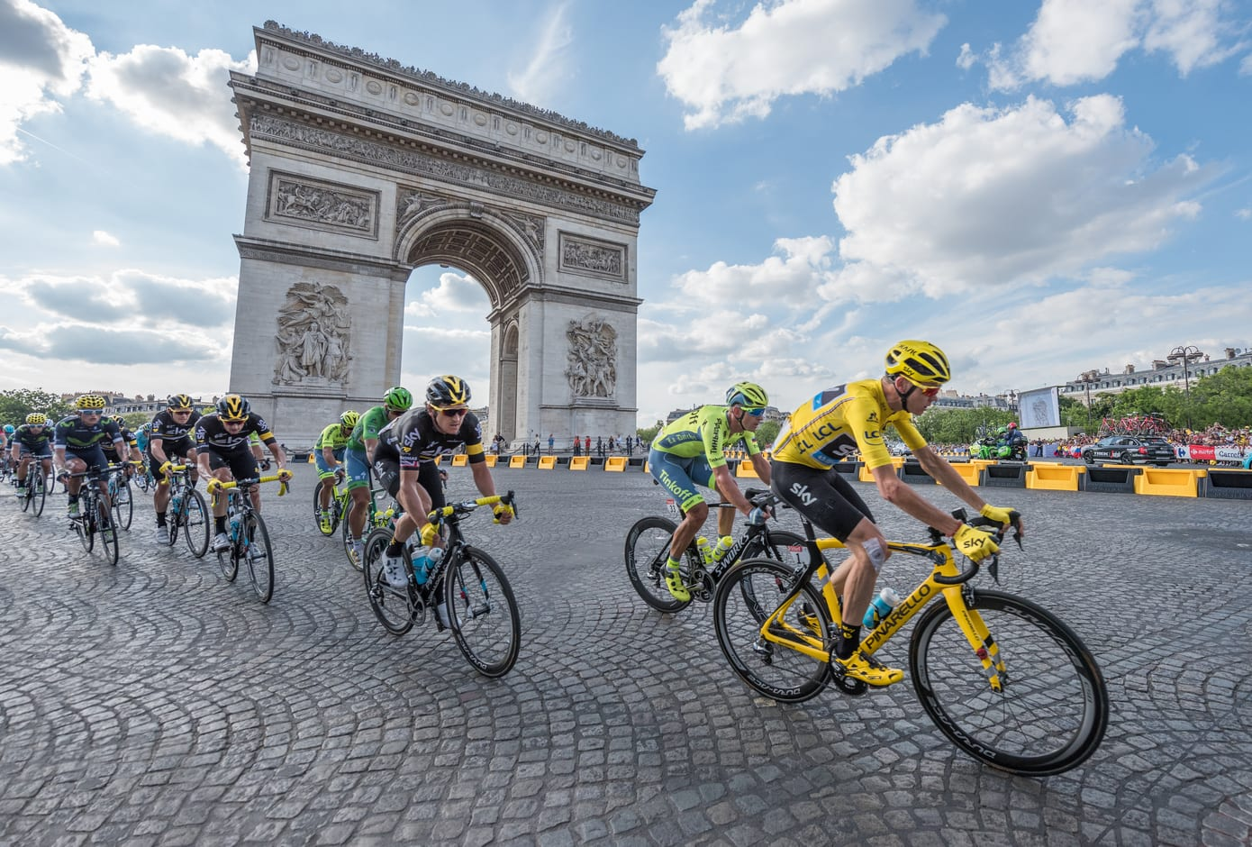 Christopher Froome, wearing the leader's yellow jersey in front of Arc de Triomphe during the Tour de France on the Champs Elysees Avenue.