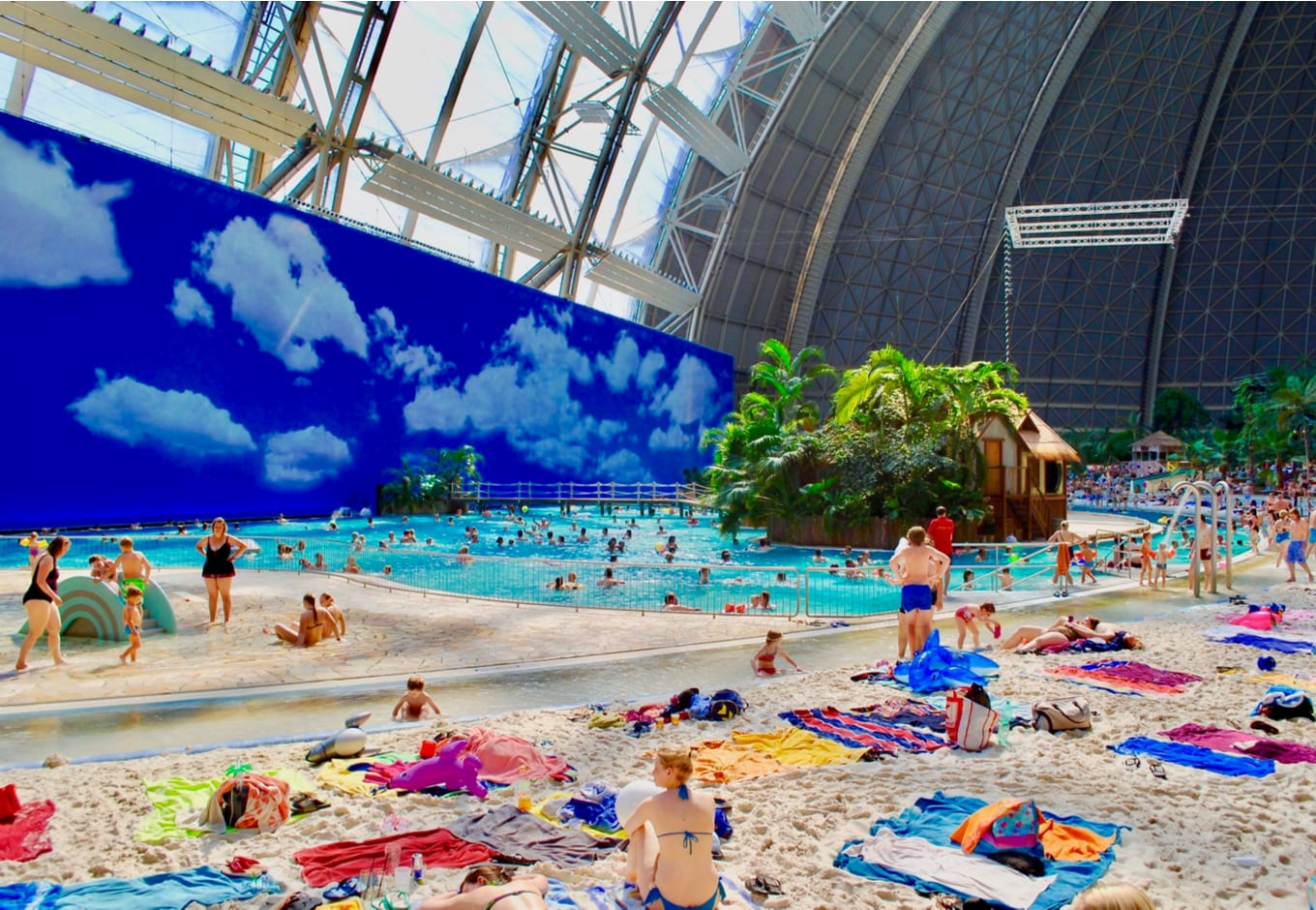 View the sandy beach by the pool at the Tropical Islands Water Park, in Germany.