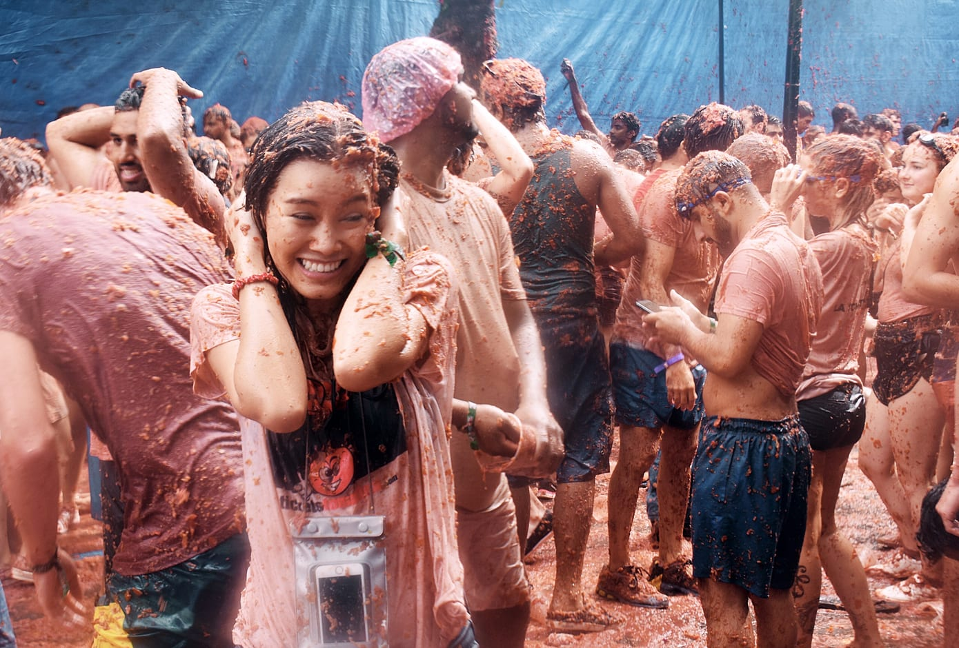 A woman covered in tomato juice during La Tomatina Festival, Bunol, Spain