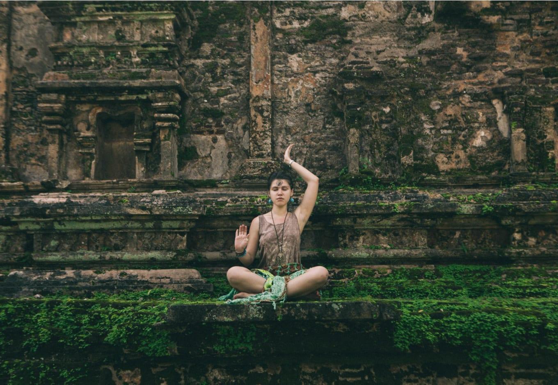 Yoman doing a yoga pose in Sri Lanka.