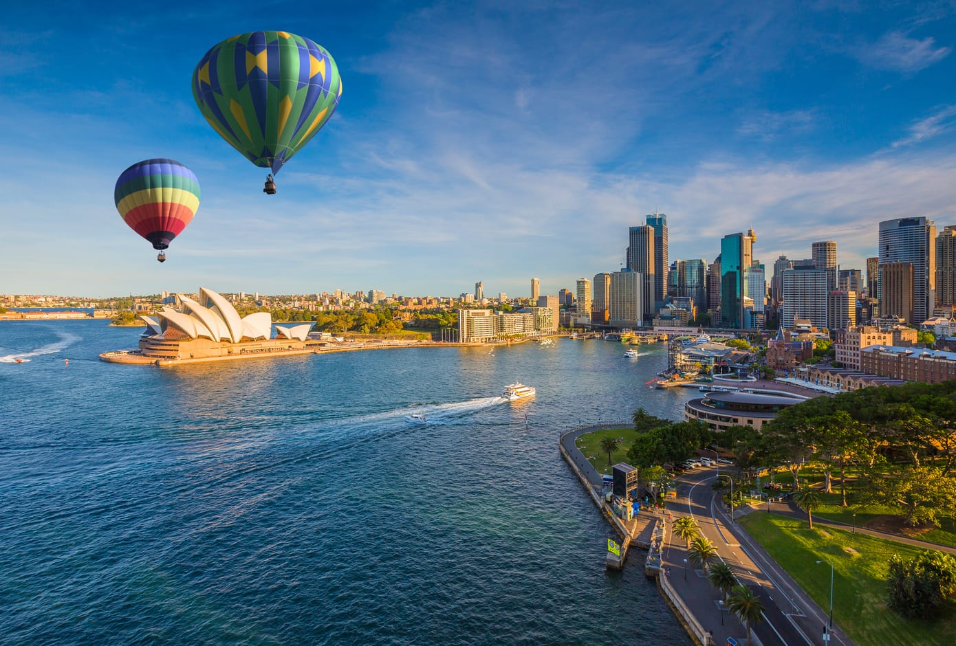 Two hot air balloons flying over the Sydney bay, in Sydney, Australia.