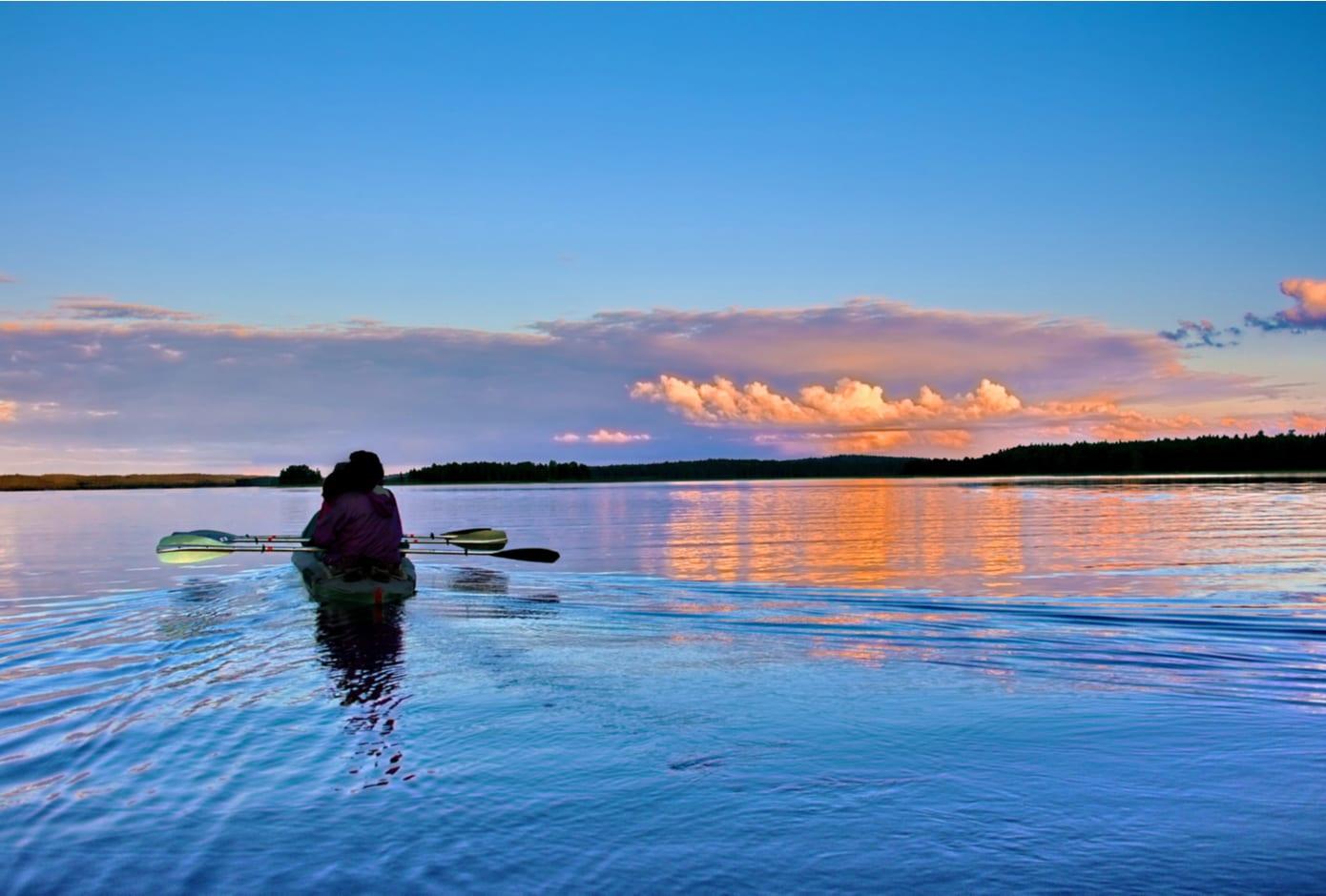 Two people kayaking at sunset.