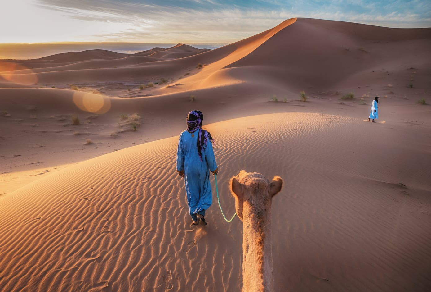 Nomad with camel in the Sahara Desert, Morocco.