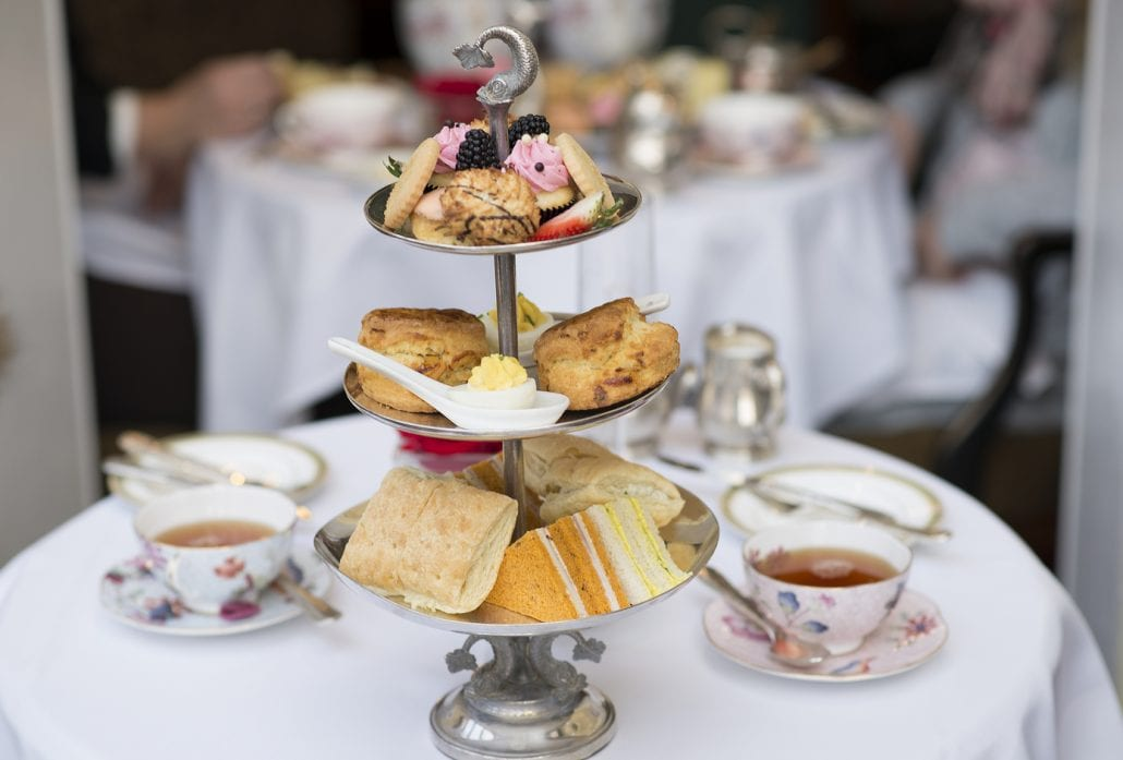 A typical British Afternoon Tea with scones, finger sandwiches and pastries.