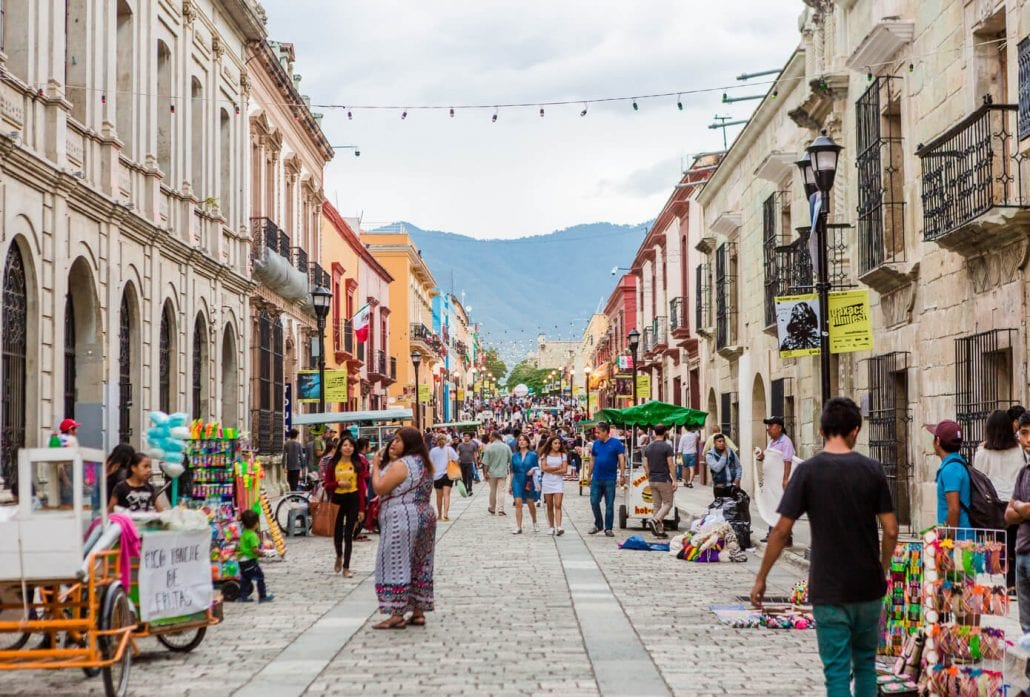 The colorful street life in the colonial city center of Oaxaca, Mexico.