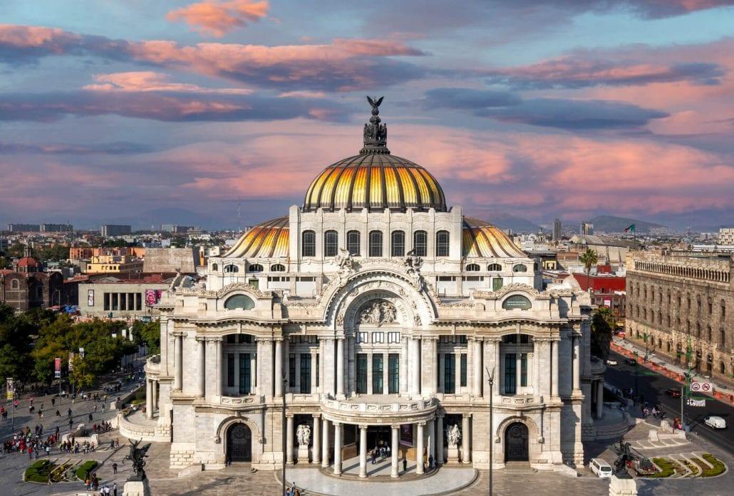 The façade of Palacio de Bellas Artes (Palace of Fine Arts), in Mexico City, at sunset.