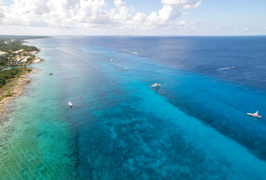 Aerial view of boats on the water heading to Palancar Reef in Cozumel Mexico.